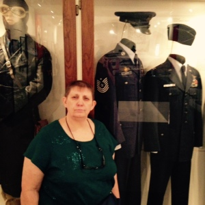 Maggie at Veteren's Museum w Dress Uniform Dad Wore