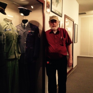 Ronnie at Veteran's Museum w Dad's Uniform